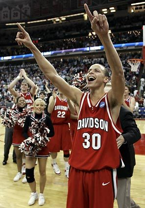 Curry is the nation's most explosive player in the clutch.  Shown here celebrating a tournament win against Gonzaga last season - he burned the nets with 30 points in the second half of that game.